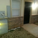 Front of unit, close proximity to garbage and electrical service