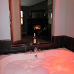 jacuzzi tub overlooking fireplace..beautiful and heavenly