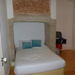 Bed in fireplace