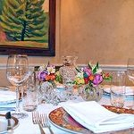 Xaviars dinning room with fresh flowers and Baccarat Crystal