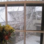 View of the snow from our room with fresh flowers from the Inn.