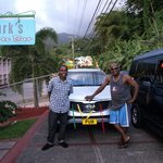 Neil our guide and Mark showing off Mark's decorated car for the independence celebration