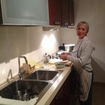 my wife preparing a meal at Casa di Tufo.