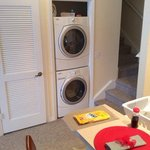 a full size washer and dryer right off the kitchen and stairwell leading to two additional rooms