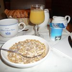 lovely continental breakfast of fruit juice, yoghurt, cheeses, croissants, rolls, coffee