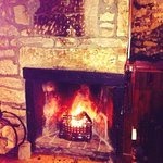 Cozy log burning fire to get you warm while having a drink at the bar