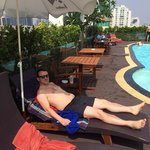 Relaxing by the rooftop pool
