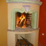 Charming fire outside room 'Geranio'