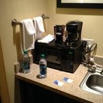 microwave - coffee pot - mini fridge and sink area