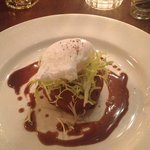 Confit duck hash cake with poached egg