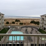 4th floor view of pool and ocean. Nice deck with barbecue