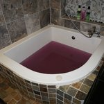 Bath with purple bath bomb