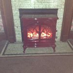 cozy and warm fireplace in mauney's suite