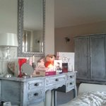 Excellently decorated room ... distressed style features