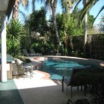 lovely yard has hot tub, pool, garden, pond, bar and patio
