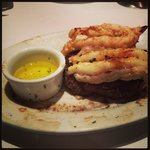 Ribeye with two lobster tails.