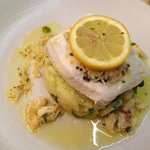 Halibut with mashed potato and a crab butter sauce