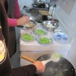 Boiling the bean curd and getting ready to add the celery