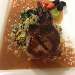 Pan seared pork chop with bamboo wild rice and a Sangria sauce..