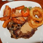 Serlion steak, onion rings, tomato, mushrooms, chips and Bonnie Prince Charlie Sauce.