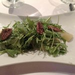 Arugula salad with poached spiced pears, creamy blue cheese crumbles and thyme vinegarette dress