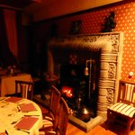 The dining room fireplace at night