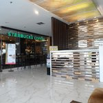 The lobby/reception and the adjoining Starbucks