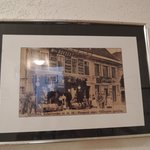 photo of old inn hanging on corridor wall
