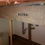 Falling apart, stilted counter in bathroom