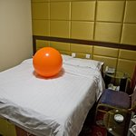 Our first room - note how small it is, and the bizzare orange ball on the bed