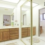 Mauka Suite private bath with vanity, closet, walk-in tiled shower