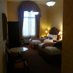 Here's a picture from the hallway in the room of the the two queen beds and high ceilings