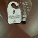 "Reduce your carbon footprint. Note to hotel, use more ""Environmentally friendly"" bulbs"