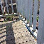 Railing on the deck is rusted and dirty