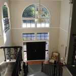 View from top of stairs to front entrance/foyer