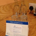 Complementary bottled mineral water and message welcome message from managing director