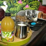 Continental breakfast selection: juices, cereals, toast and fruit