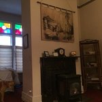 bright window, cozy fireplace, sitting room, interesting wall art
