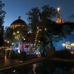 Pool & garden at night with Parroquia in the background
