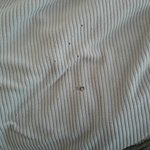 Cigarette burn holes in the blanket