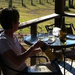 Caryl Sipping Wine Overlooking Vineyard at Sabor a Pasion