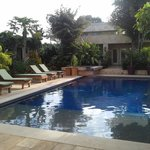 Beautiful pool and small rental house across from hotel