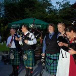 Some of the pipers gathering to play
