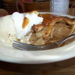 Apple pie with ice cream and carmel.