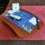 This lap desk with remote and writing materials was conveniently placed on the end of our bed.