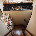 The little staircase to the attic room is full of wonderful bits & bobs