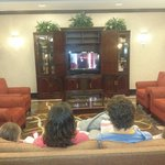 Family watching tv in the lobby