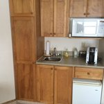 small kitchenette in bachelor room (electric hotplate in cupboard)