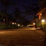 The walkway between the villas at night..