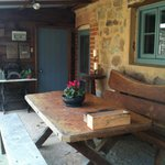 Enjoy a glass of wine or your evening meal on the back veranda of The Miners Cottage